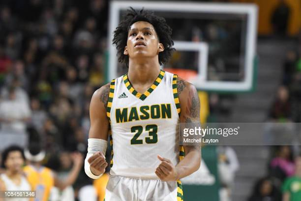 Javon Greene of the George Mason Patriots celebrates a shot during a college basketball game against the Southern University Jaguars at the Eagle...