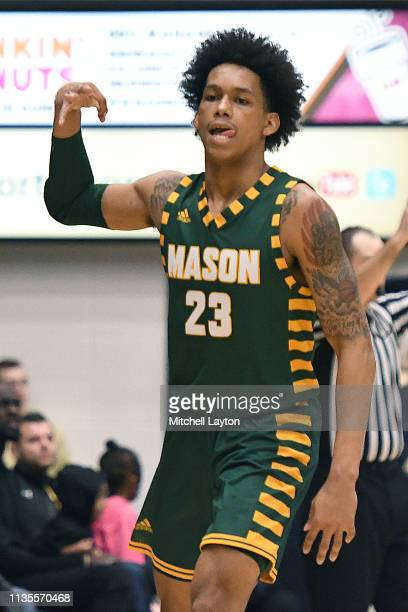 Javon Greene of the George Mason Patriots celebrates a shot during a college basketball game against the George Washington Colonials at the Smith...