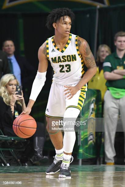 Javon Greene of the George Mason Patriots dribbles the ball during a college basketball game against the Southern University Jaguars at the Eagle...