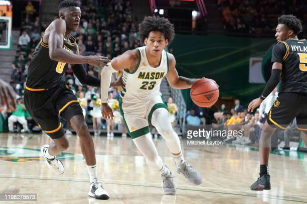 Javon Greene of the George Mason Patriots dribbles the ball during a college basketball game against the Virginia Commonwealth Rams at the Eagle Bank...
