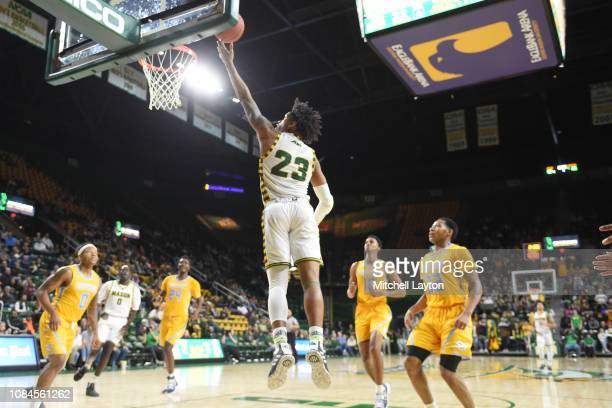 Javon Greene of the George Mason Patriots drives to the basket during a college basketball game against the Southern University Jaguars at the Eagle...