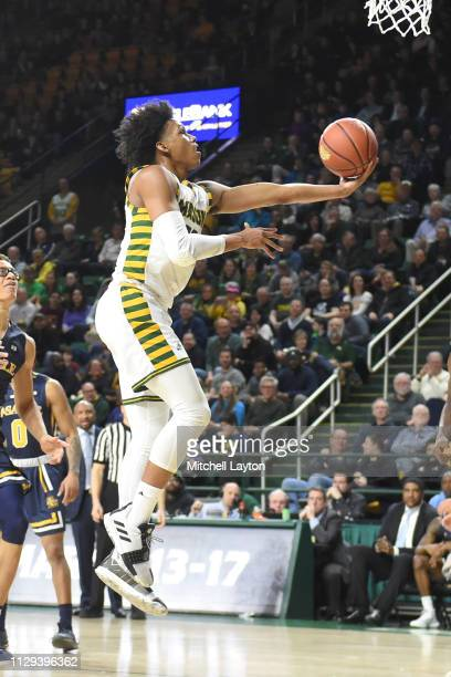 Javon Greene of the George Mason Patriots drives to the basket during a college basketball game against the La Salle Explorers at the Eagle Bank...
