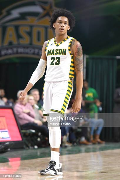 Javon Greene of the George Mason Patriots looks on during a college basketball game against the La Salle Explorers at the Eagle Bank Arena on...