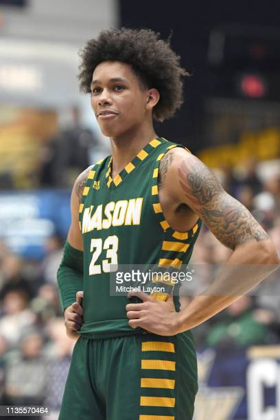 Javon Greene of the George Mason Patriots looks on during a college basketball game against the George Washington Colonials at the Smith Center on...