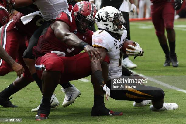 Javon Kinlaw defensive lineman of South Carolina tackles Tyer Badie running back of Missouri during a college football game between the Missouri...
