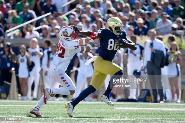 Javon McKinley of the Notre Dame Fighting Irish breaks a tackle from Johnny Hernandez of the New Mexico Lobos to score a touchdown in the second...