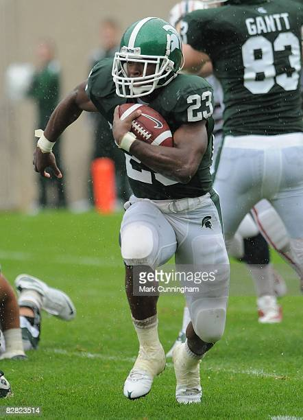 Javon Ringer of the Michigan State Spartans carries the ball against the Florida Atlantic University Owls on September 13, 2008 at Spartan Stadium in...