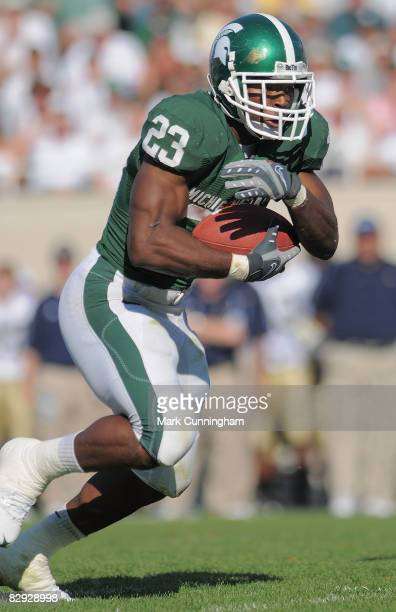 Javon Ringer of the Michigan State Spartans carries the ball against the Notre Dame Fighting Irish on September 20, 2008 at Spartan Stadium in East...