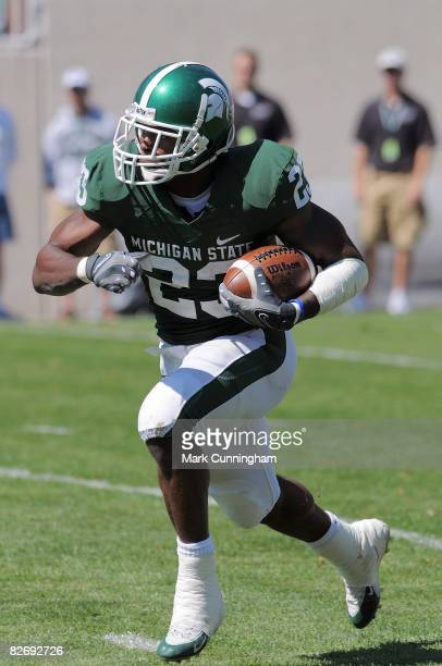 Javon Ringer of the Michigan State Spartans carries the ball while playing the Eastern Michigan Eagles on September 6 2008 at Spartan Stadium in East...