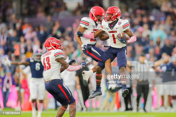 Javon Scruggs of the Liberty Flames celebrates after an interception during the second quarter against the Georgia Southern Eagles in the 2019 Cure...