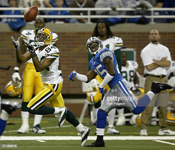 Javon Walker of the Green Bay Packers catches a pass defended by Fernando Bryant of the Detroit Lions on October 17 2004 at Ford Field in Detroit...