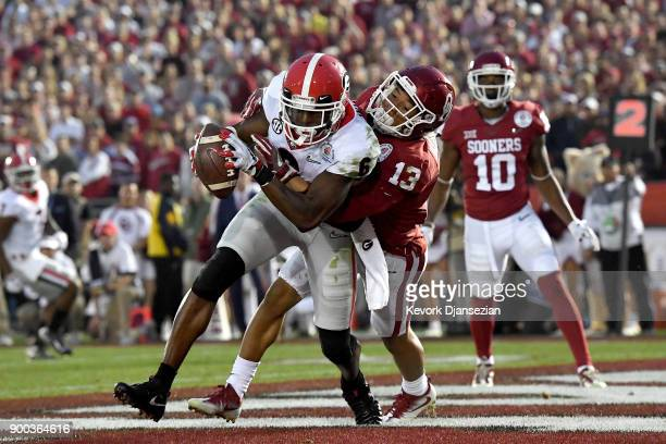Javon Wims of the Georgia Bulldogs catches the 4 yard pass for a touchdown in the 2018 College Football Playoff Semifinal Game against the Oklahoma...