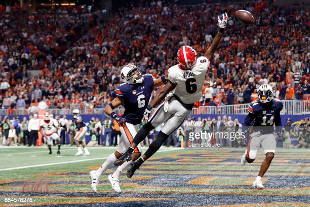 Javon Wims of the Georgia Bulldogs fails to pull in a catch against Carlton Davis of the Auburn Tigers during the first half in the SEC Championship...