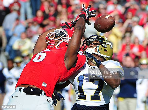 Javon Wims of the Georgia Bulldogs goes up for a pass defended by Lance Austin of the Georgia Tech Yellow Jackets at Sanford Stadium on November 26...