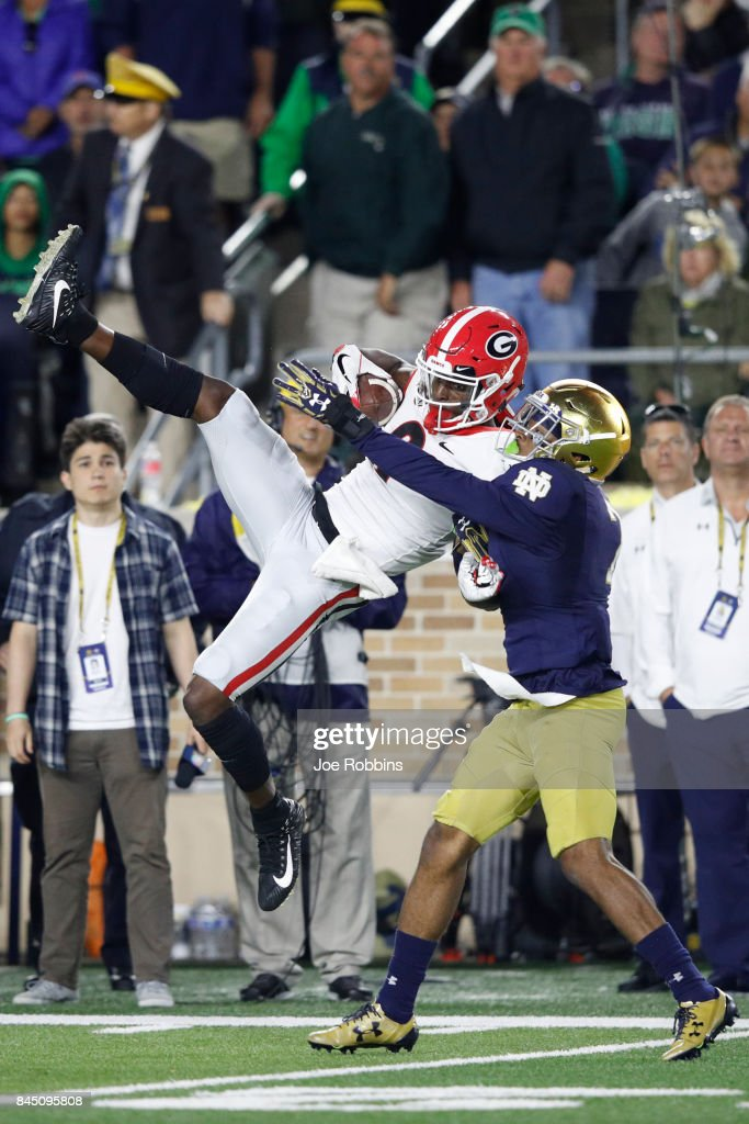 Javon Wims #6 of the Georgia Bulldogs makes a 31-yard reception to set up the go ahead field goal against the Notre Dame Fighting Irish in the fourth quarter of a game at Notre Dame Stadium on September 9, 2017 in South Bend, Indiana. Georgia won 20-19.