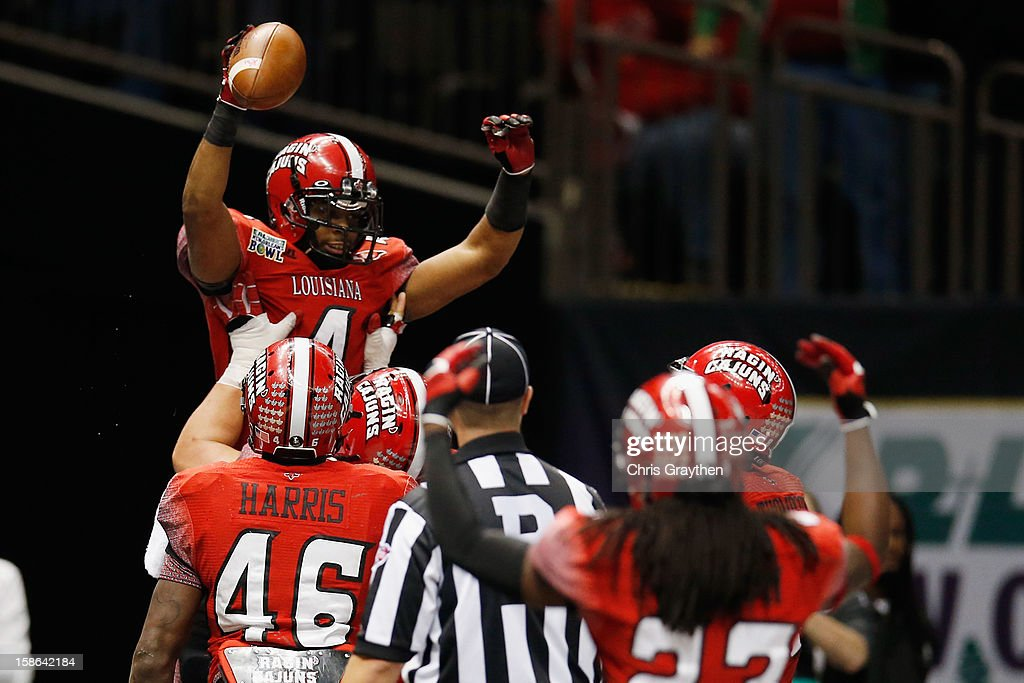 Javone Lawson #4 of the Louisiana-Lafayette Ragin Cajuns celebrates after scoring a touchdown against the East Carolina Pirates during the R+L Carriers New Orleans Bow at the Mercedes-Benz Superdome on December 22, 2012 in New Orleans, Louisiana.