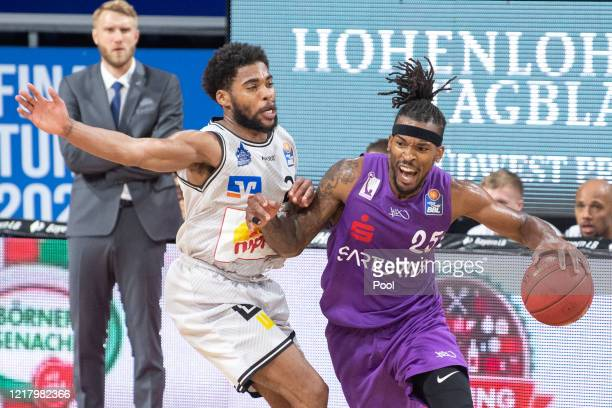 Javontae Hawkins of HAKRO Merlins Crailsheim challenges Terry Allen of BG Goettingen during the EasyCredit Basketball Bundesliga match between BG...