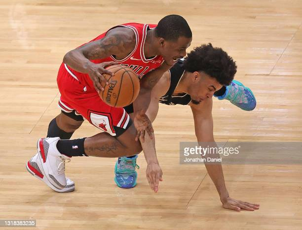 Javonte Green of the Chicago Bulls is fouled by Jordan Nwora of the Milwaukee Bucks at the United Center on May 16, 2021 in Chicago, Illinois. NOTE...