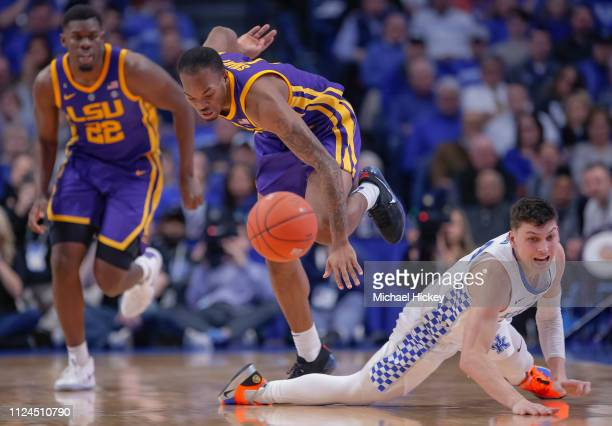 Ja'vonte Smart of the LSU Tigers and Tyler Herro of the Kentucky Wildcats chase down a loose ball during the game at Rupp Arena on February 12 2019...