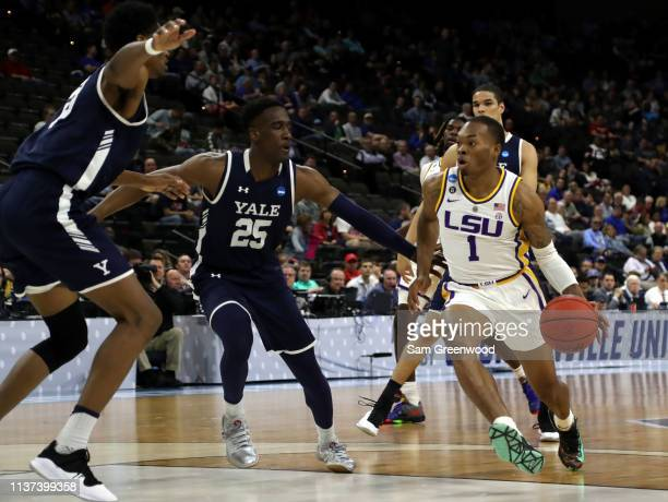 Javonte Smart of the LSU Tigers dribbles the ball against Miye Oni of the Yale Bulldogs during the first round of the 2019 NCAA Men's Basketball...