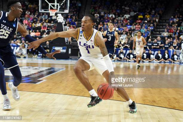 Javonte Smart of the LSU Tigers dribbles the ball during the First Round of the NCAA Basketball Tournament against the Yale Bulldogs at the VyStar...