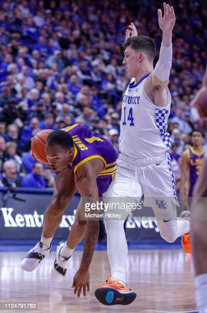 Ja'vonte Smart of the LSU Tigers drives to the basket against Tyler Herro of the Kentucky Wildcats during the game at Rupp Arena on February 12 2019...