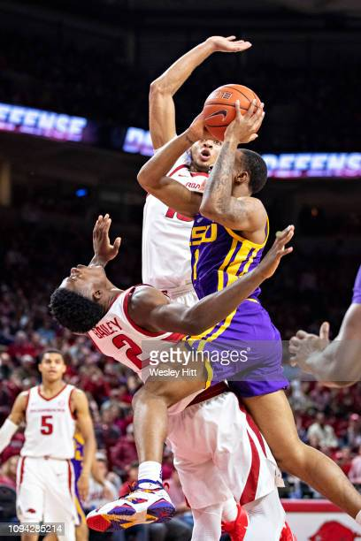 Ja'Vonte Smart of the LSU Tigers drives to the basket and charges into Adrio Bailey of the Arkansas Razorbacks at Bud Walton Arena on January 12 2019...