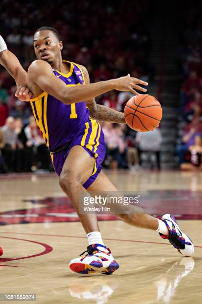 Ja'Vonte Smart of the LSU Tigers drives to the basket during a game against the Arkansas Razorbacks at Bud Walton Arena on January 12 2019 in...