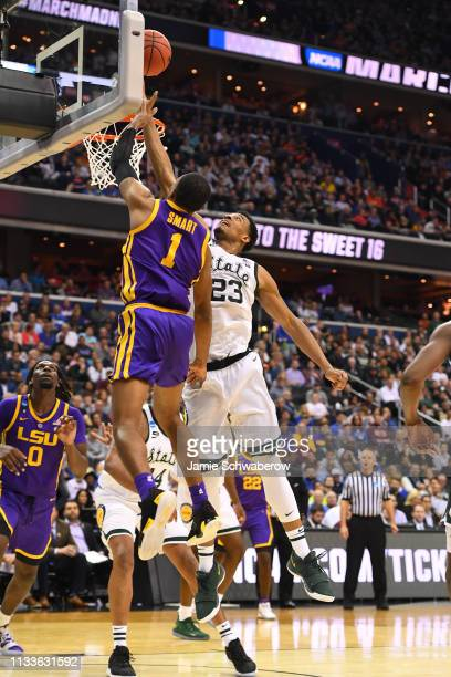 Javonte Smart of the LSU Tigers lays up a shot over Xavier Tillman of the Michigan State Spartans in the third round of the 2019 NCAA Photos via...