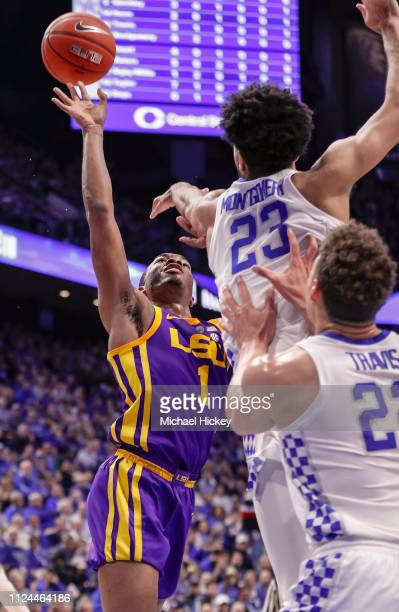Ja'vonte Smart of the LSU Tigers shoots the ball as EJ Montgomery of the Kentucky Wildcats reaches to defend the shot during the first half of action...