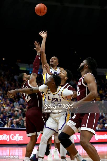 Ja'vonte Smart of the LSU Tigers shoots the ball over TJ Starks of the Texas AM Aggies during a game at Pete Maravich Assembly Center on February 26...