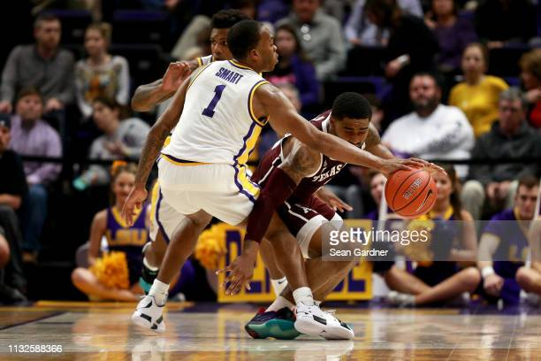 Ja'vonte Smart of the LSU Tigers steals the ball from TJ Starks of the Texas AM Aggies during a game at Pete Maravich Assembly Center on February 26...
