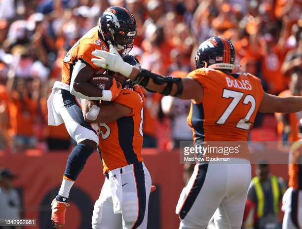 Javonte Williams of the Denver Broncos is congratulated by Albert Okwuegbunam after Williams' rushing touchdown in the first quarter of the game...