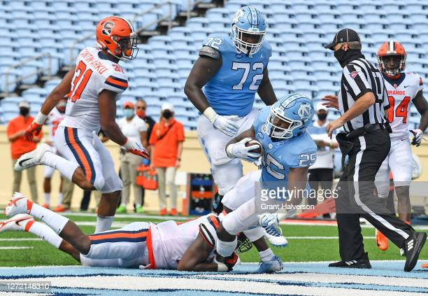 Javonte Williams of the North Carolina Tar Heels scores a touchdown against the Syracuse Orange during the fourth quarter of their game at Kenan...