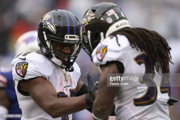 Javorius Allen and Alex Collins of the Baltimore Ravens celebrate after a touchdown in the third quarter against the Buffalo Bills at MT Bank Stadium...