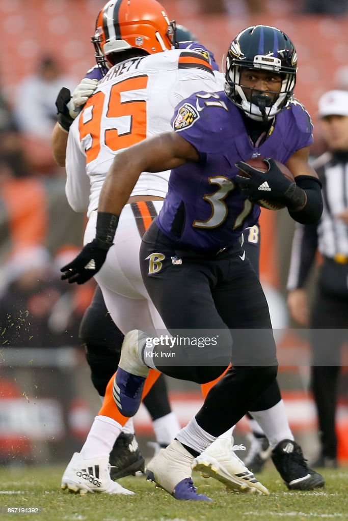 Javorius Allen #37 of the Baltimore Ravens carries the ball during the game against the Cleveland Browns at FirstEnergy Stadium on December 17, 2017 in Cleveland, Ohio. Baltimore defeated Cleveland 27-10. (Photo by Kirk Irwin/Getty Images) *** Javorius Allen