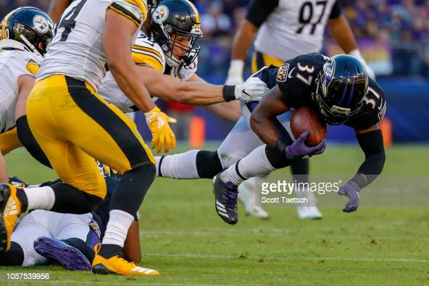 Javorius Allen of the Baltimore Ravens catches a pass against the Pittsburgh Steelers during the fourth quarter at MT Bank Stadium on November 4 2018...