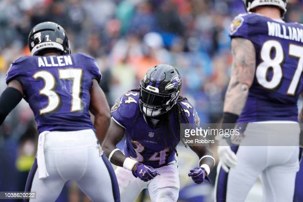 Javorius Allen of the Baltimore Ravens celebrates with Alex Collins after rushing for a oneyard touchdown in the third quarter of the game against...