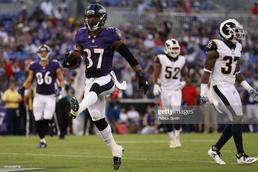 Javorius Allen #37 of the Baltimore Ravens in action against the Los Angeles Rams in the first half during a preseason game at M&T Bank Stadium on August 9, 2018 in Baltimore, Maryland.
