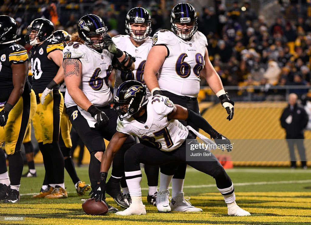 Javorius Allen #37 of the Baltimore Ravens reacts after rushing for a 1 yard touchdown in the third quarter during the game against the Pittsburgh Steelers at Heinz Field on December 10, 2017 in Pittsburgh, Pennsylvania.