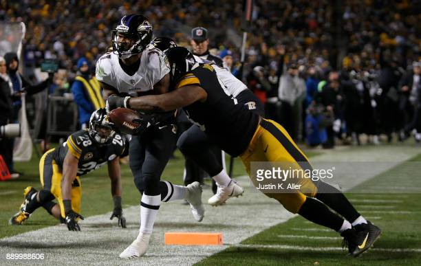 Javorius Allen of the Baltimore Ravens rushes for a 9 yard touchdown in the fourth quarter during the game against the Pittsburgh Steelers at Heinz...