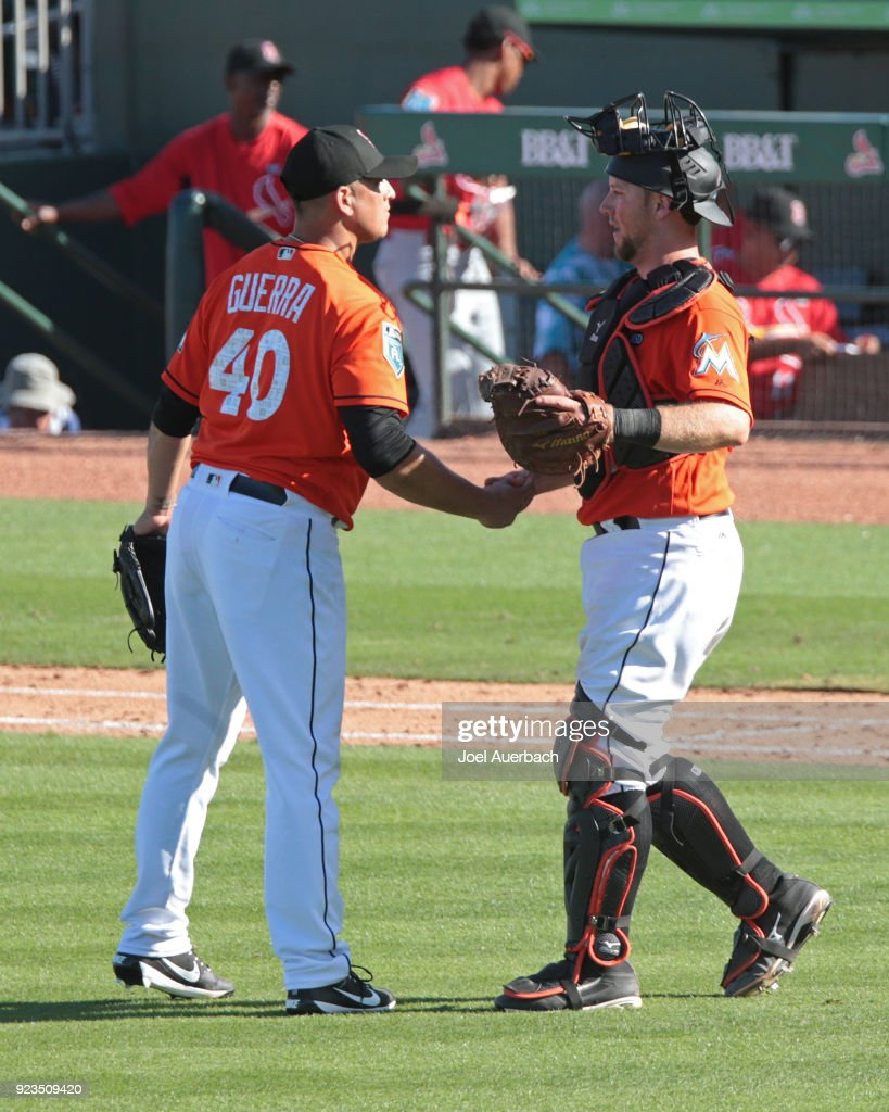 Javy Guerra #40 is congratulated by Bryan Holaday #28 of the Miami Marlins after the final out against the St Louis Cardinals during a spring training game at Roger Dean Chevrolet Stadium on February 23, 2018 in Jupiter, Florida. The Marlins defeated the Cardinals 6-4.