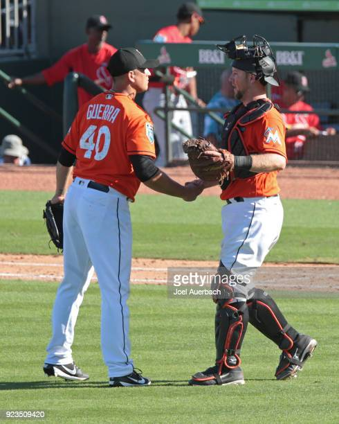 Javy Guerra is congratulated by Bryan Holaday of the Miami Marlins after the final out against the St Louis Cardinals during a spring training game...