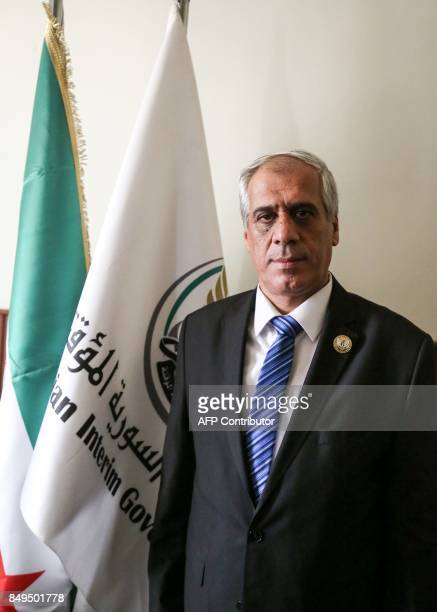 Jawad Abu Hatab head of the provisional Syrian opposition government poses for a photograph at a press conference in the northern town of Azaz on the...
