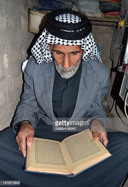 Jawad alShammari reads the Koran Islam's holy book in the basement where he lived for more than 20 years under the former regime of Saddam Hussein in...