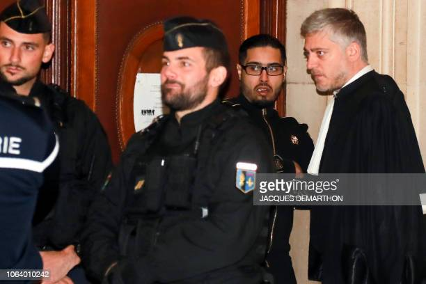 Jawad Bendaoud flanked by his lawyer Xavier Nogueras arrives at the Paris courthouse to attend his appeal trial in Paris on November 21 2018...