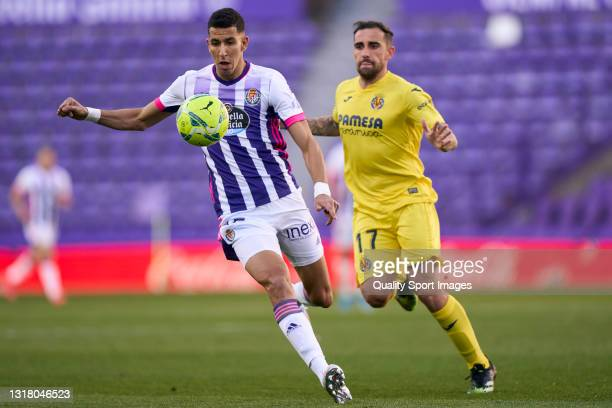 Jawad El Yamiq of Real Valladolid battle for the ball with Paco Alcacer of Villarreal CF during the La Liga Santander match between Real Valladolid...