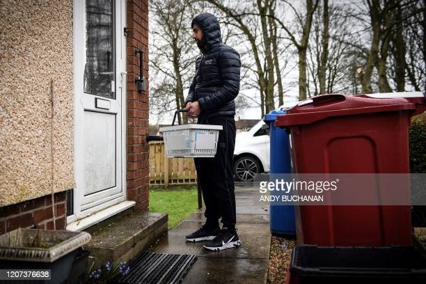 Jawad Javed delivers coronavirus protection kits that he and his wife have put together to the vulnerable people of his community of Stenhousemuir,...