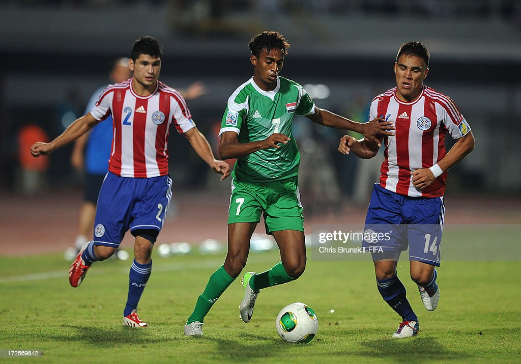 Jawad Kadhim of Iraq in action with Aquilino Gimenez (R) of Paraguay during the FIFA U20 World Cup Round of 16 match between Iraq and Paraguay at Akdeniz University Stadium on July 03, 2013 in Antalya, Turkey.