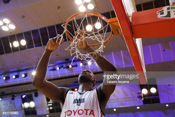 Jawad Williams of the Alvark Tokyo cuts down the net after defeating the Chiba Jets 77-73 in the B.League Kanto Early Cup final between Alvark Tokyo...